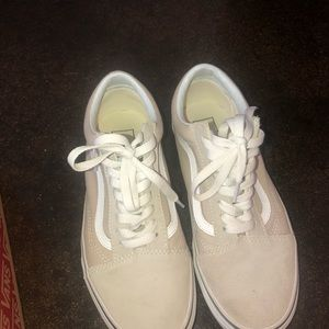 tan and white vans.